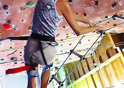 camp-kid-climbing-rock-wall-450x600